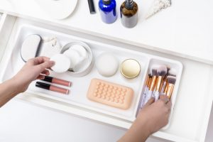 woman-hands-taking-cosmetic-cotton-pad-brush-inside-opened-driwes_181654-128